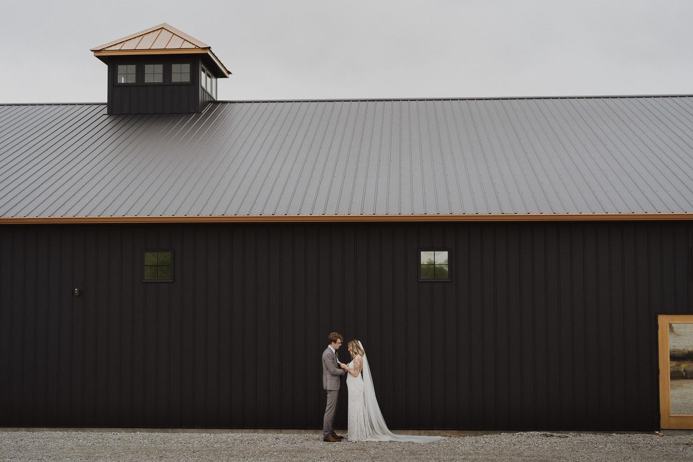 willow-brooke-farm-venue-arkansas-wedding-photographer-black-barn-bride-groom-reading-vows-during-first-look