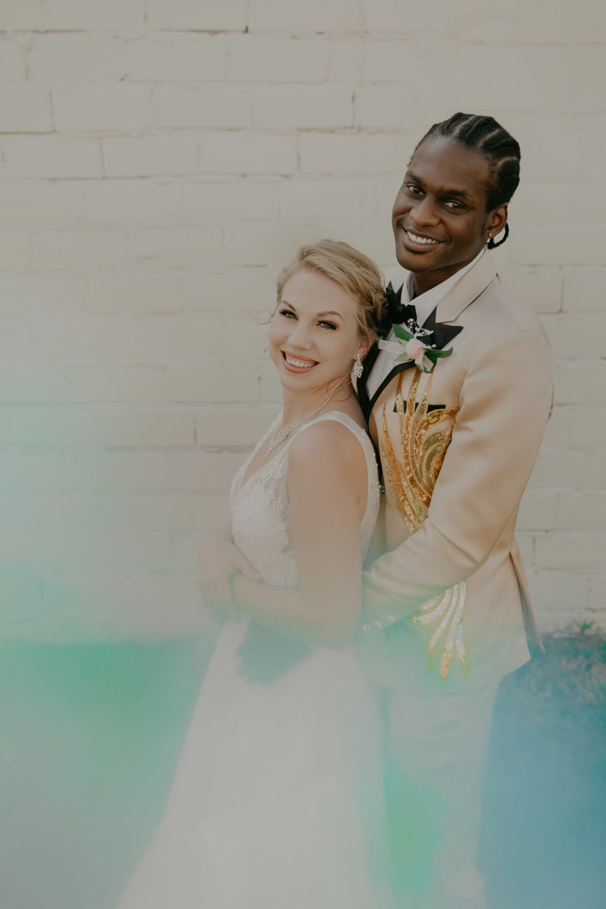 interracial-couple-black-white-pearl-district-building-wedding-creame-embroidered-flame-suit-tulsa-photographer