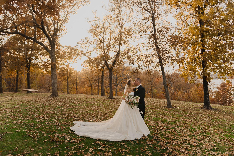 springs-venue-skiatook-lake-fall-wedding-under-autumn-leaves-sunset-couple-bride-and-groom-tulsa-wedding-photographer