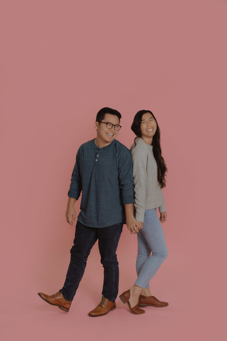 studio-couple-engagement-session-pink-backdrop-background-casual-outfits-tulsa-wedding-photographer