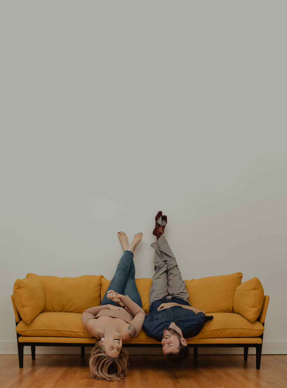 couple-engagement-session-photos-yellow-couch-sitting-upside-down-laughing-holding-hands-tulsa-photographer