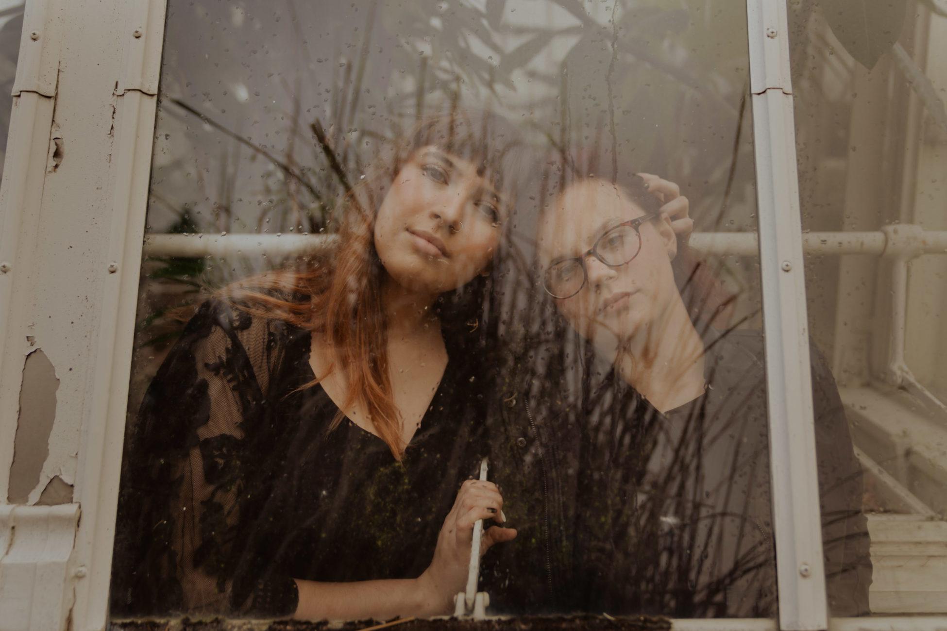 lgbtq-couple-window-rain-photo-tulsa-photographer