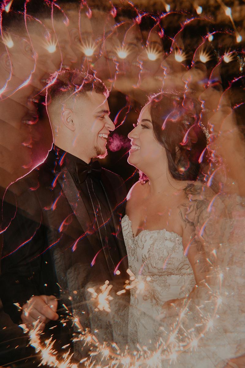 silo-event-center-tulsa-wedding-photographer-purple-color-pallete-poc-couple-sparkler-exit-creative-unique-portraits