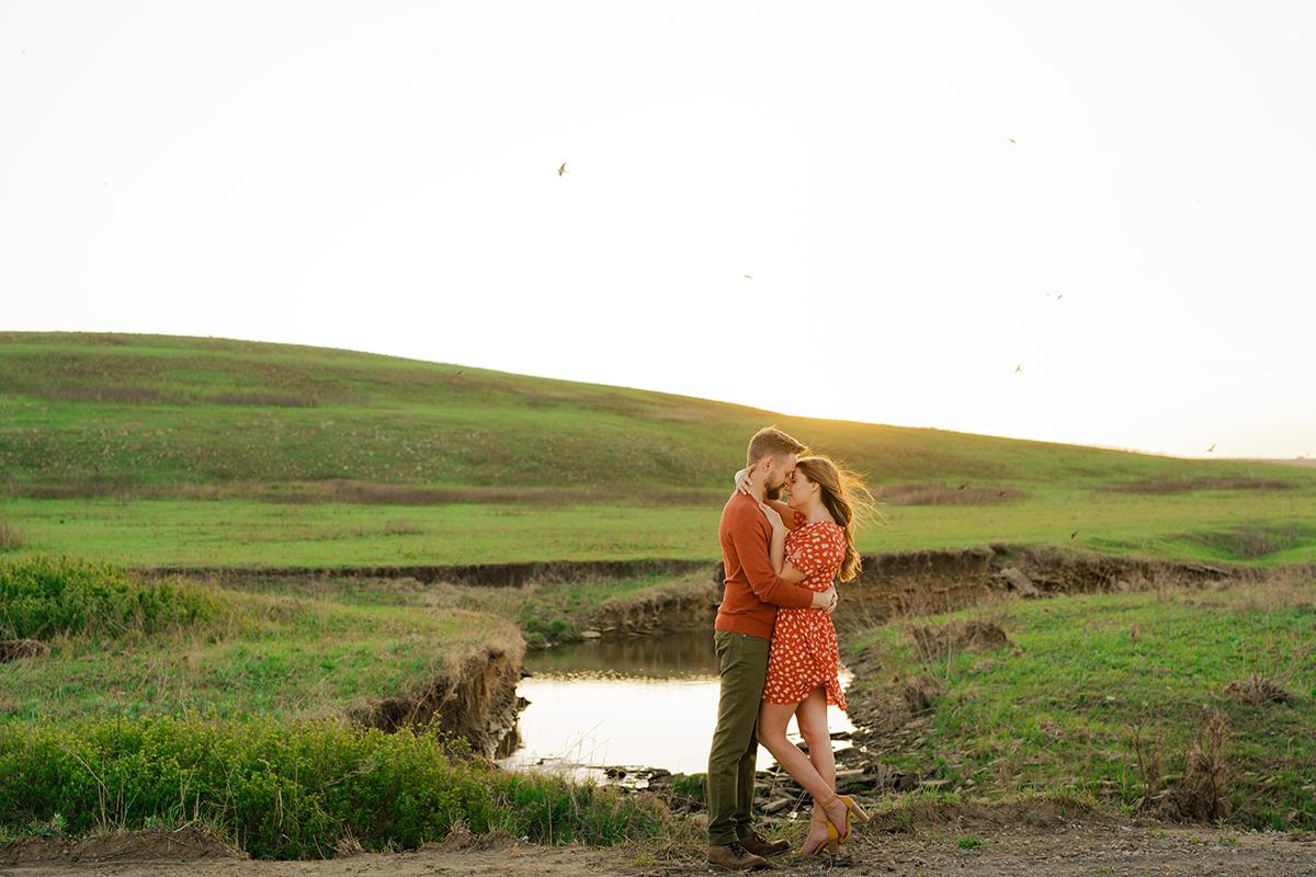 tallgrass-prairie-preserve-engagement-session-couple-photos-rolling-hills-creek-birds-flying-sunset-golden-hour
