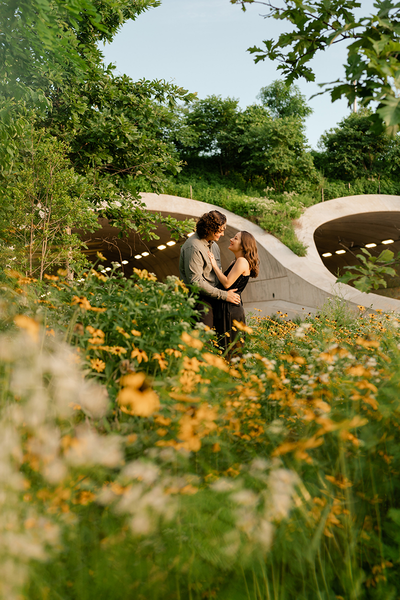 gathering-place-tulsa-couple-engagement-session-wildflowers-tunnel